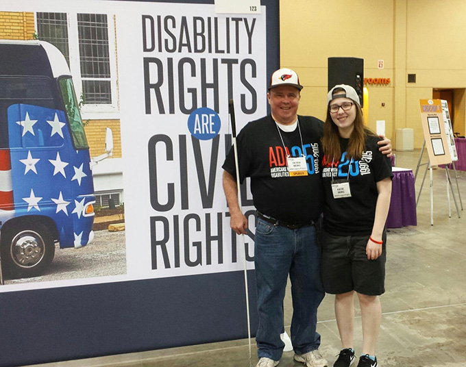 Great Lakes ADA Center staff member Peter Berg and daughter Katie Berg at the Chicago Abilities Expo, Schaumburg, IL