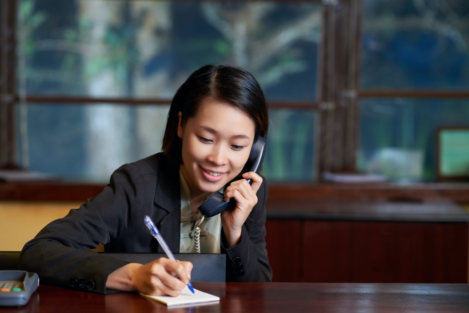 A hotel receptionist talking on the phone