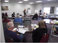 A photo of a Town Hall meeting to identify barriers