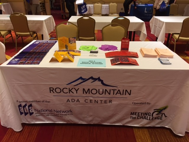 Image of display table with Rocky Mountain ADA Center name and materials.