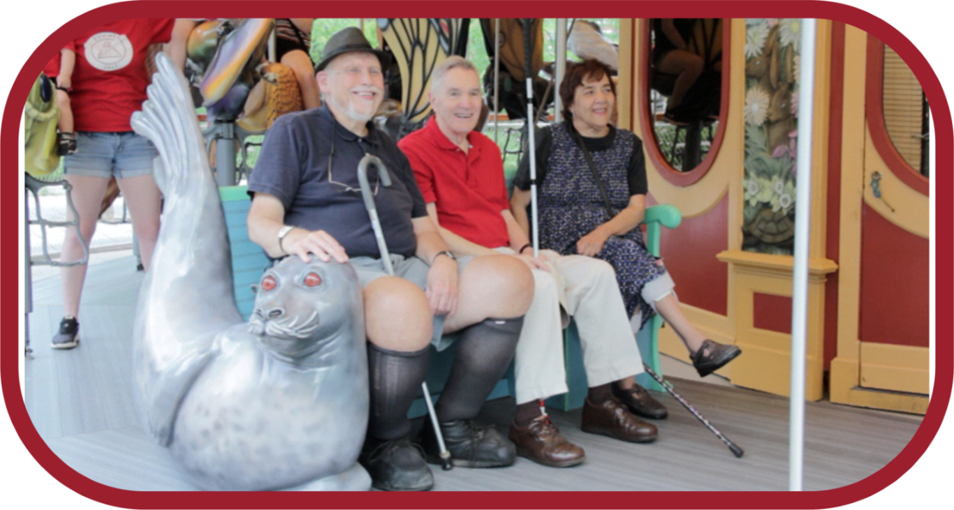 three elderly people on a carousel